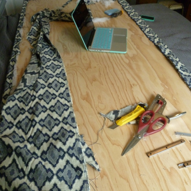 Trim excess fabric. (You can even use the plywood to rest this tutorial on your laptop!)
